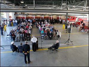 Robert Lesinski, chaplain of the Toledo Fire and Rescue Department, leads the invocation during a 9/11 Commemoration Ceremony and Dedication of Fire Station 6 at 1155 Oak Street, Tuesday, September 11, 2012.