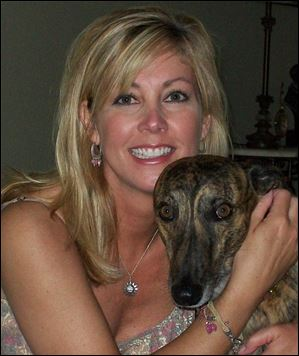 Carla Woodell with her dog, Blitzen.