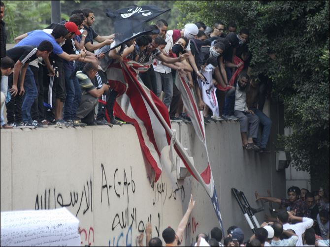 Mideast Egypt US islam offended FILM Protesters destroy an American flag pulled down from the U.S. embassy in Cairo, Egypt. Egyptian protesters, largely ultra conservative Islamists, have climbed the walls of the U.S. embassy in Cairo, went into the courtyard and brought down the flag, replacing i