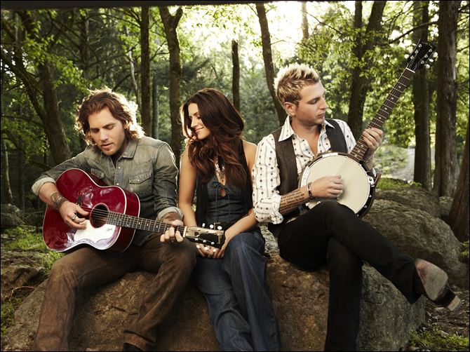 From left, Tom Gossin, Rachel Reinert, and Mike Gossin From left, Tom Gossin, Rachel Reinert, and Mike Gossin of the country trio, Gloriana.