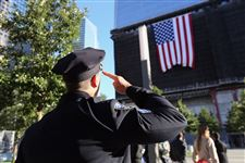 A-New-York-City-Police-officer-salutes-a-flag