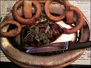 Top sirloin with onion rings.