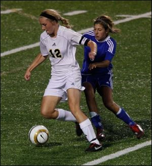 Perrysburg's Maddy Williams gets in front of Anthony Wayne's Abby Allen in last night's Northern Lakes League soccer game. Williams scored three goals as the Yellow Jackets, ranked No. 1 in Ohio, won 4-0 over the No. 10-ranked Generals.