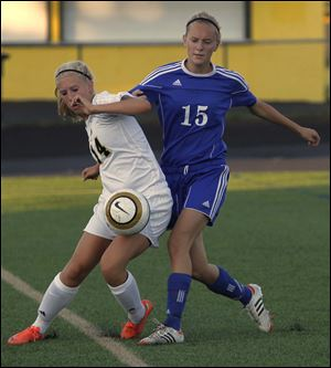 Perrysburg's Abby Sattler, left, and Anthony Wayne's Abbi Schneider battle for the ball in a Northern Lakes League contest between two state-ranked teams.