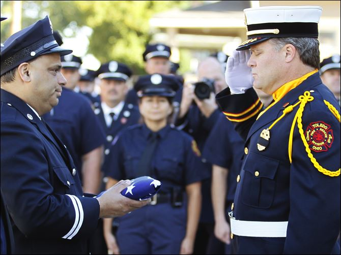 Fire Station 6 Captain Dave Rodriguez Fire Station 6 Captain Dave Rodriguez, left, accepts the station flag from Private Jeff Koenigseker, commander of the Toledo Fire Department Honor Guard, during a 9/11 Commemoration Ceremony and Dedication of Fire Station 6 at 1155 Oak Street, Tuesday.