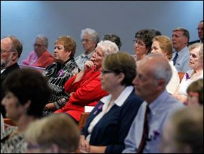 The congregation at First Unitarian Church Thursday listens during the ordination Mass.