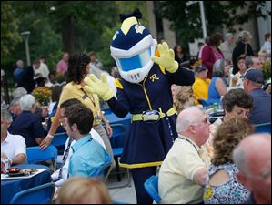 Toledo mascot Rocksy the Rocket was on hand to work the crowd of several hundred people Thursday evening during the dedication of the new William and Carol Koester Alumni Pavilion.