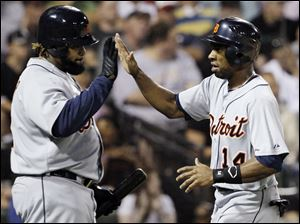 Detroit Tigers' Austin Jackson, right, celebrates with Prince Fielder after scoring on a single hit by Miguel Cabrera during the fifth inning Wednesday night.