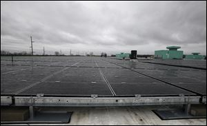 One of the automaker's biggest solar projects is a rooftop array at the GM Toledo Transmission Plant on Alexis Road that's expected to eventually generate 1.8 megawatts of electricity.