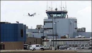 Asight that may happen more often: a flight leaves Toledo Express Airport.