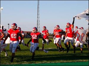 Patrick Henry takes the field against Liberty Center on Friday Hamler.