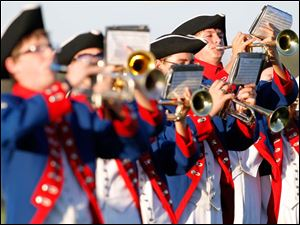 The Patrick Henry band performs during the game.