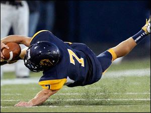 Whitmer High School quarterback Nick Holley, 7, dives for extra yardage during the second quarter at Whitmer High School.