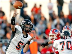 Liberty Center quarterback Josh Drain throws the ball.