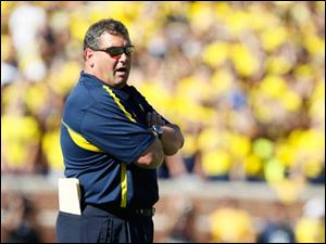 University of Michigan head coach Brady Hoke watches his team play the University of Massachusetts during the first quarter at Michigan Stadium in Ann Arbor.
