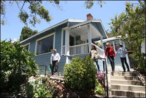 Potential buyers tour a home for sale in the Highland Park neighborhood of Los Angeles, California.