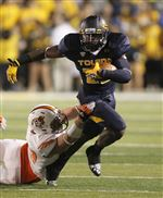 Toledo-running-back-David-Fluellan-carries-the-ball