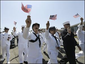 Sailors march in uniform during the gay pride parade in San Diego in July.