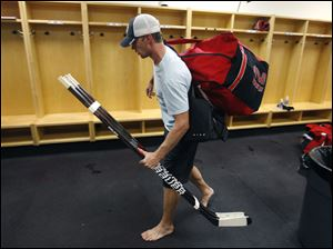 Carolina Hurricanes' Eric Staal leaves the locker room after an informal workout Friday, in Raleigh, N.C. Staal was taking his gear, which is normally stored in the lockers, with him as the players will not be allowed to use the facility during the lockout.