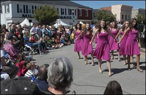 Perrysburg High School's Women's Select Show Choir performs at the Harrison Rally Day festival in downtown Perrysburg. Festival-goers also were treated to a fine art show Saturday.