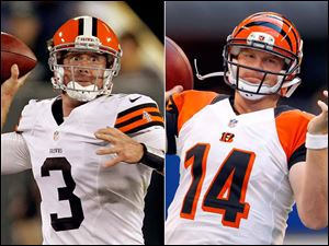The Browns' Brandon Weeden, left, was named the team's starter despite being a rookie. There's a good chance today's game against the Bengals will be the first of many times that he faces Andy Dalton.