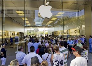 A line of customers enter an Apple store  in Scottsdale, Ariz. Delivery times climbed quickly as Apple Inc. started taking orders for the iPhone 5 on Friday. The iPhone 5 that Apple with only incremental changes seemed to signal that the industry has entered an era of technological bunny hops.