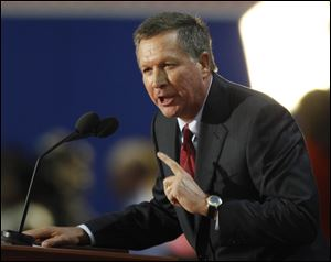 Ohio Governor John Kasich speaks to delegates last month during the Republican National Convention in Tampa.