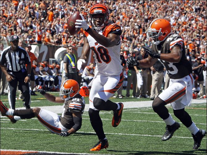 Browns Bengals Football Cincinnati wide receiver A.J. Green scores on a pass reception past after sliding past Browns cornerback Dimitri Patterson.