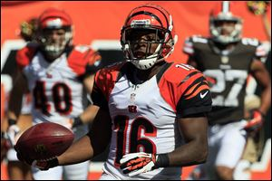 Cincinnati Bengals wide receiver Andrew Hawkins (16) scores on a pass reception in the second half of an NFL football game against the Cleveland Browns, Sunday, Sept. 16, 2012.
