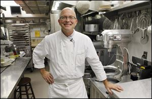 White House pastry chef Bill Yosses as he poses in his kitchen.