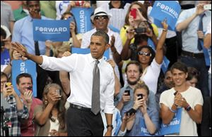 President Barack Obama waves to supporters after speaking at a campaign event at Schiller Park in Columbus, Ohio.
