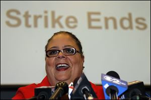 Karen Lewis, president of the Chicago Teachers Union smiles as she talks with reporters Tuesday after the union's House of Delegates voted to suspend the strike.