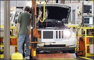 Toledo-area Chrysler dealers say they were impressed by the announcement show put on by the company in Las Vegas. The manufacturer announced its plans for the replacement of the Jeep Liberty, seen here being made in Toledo, at the show but what was revealed in Vegas stayed in Vegas.
