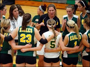 Oregon Clay head coach Tracy Donnelly talks to her team.