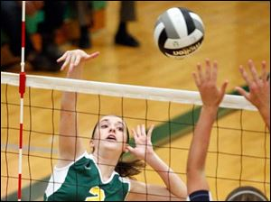 Clay's Lydia Winckowski (2) spikes the ball against Notre Dame's Madeline Smyth.