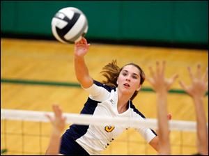 Notre Dame's Madeline Smyth spikes the ball.