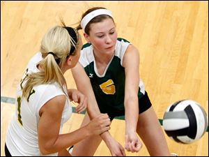 Clay's Kallie Seimet and Megan Ladd (1) try to return a  Notre Dame serve.