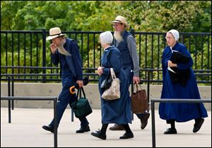 Members of the Amish community enter the U.S. Federal Courthouse in Cleveland.