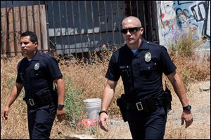 "This film image released by Open Road Films shows Michael Pena, left, and Jake Gyllenhaal in a scene from ""End of Watch."""
