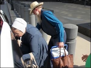 An amish woman and man climb into a van after a verdict in the beard cutting trial Thursday, Sept. 20, at Federal Court in Cleveland. All 16 defendants were found guilty.