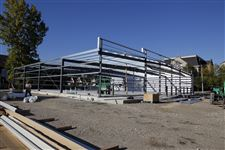Workers-erect-the-frame-of-a-new-Family-Dollar-store