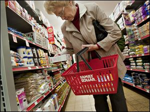 Customer Helen Buckley shops at a Family Dollar Store in Sterling, Ill. The discount store chain is joining many others in adapting stores to accommodate the aging population.