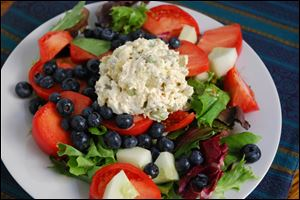 Delicious Southern Style Chicken Salad on a bed of greens, fruits and veggies.