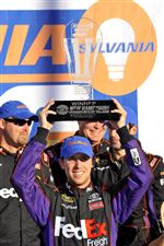 Denny-Hamlin-celebrates-his-win-in-victory-lane