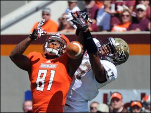 Virginia Tech cornerback Kyle Fuller (17) breaks up a pass against Bowling Green wide receiver Chris Galion (81) during the first half Saturday, Sept. 22, in Blacksburg, Va.