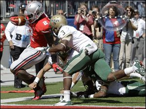 Ohio State's Rod Smith is knocked out of bounds just short of the goal line.