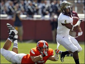 Bowling Green's Corey Marshall tries to pull down Virginia Tech' J.C. Coleman.