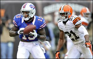 Buffalo Bills wide receiver Stevie Johnson catches a nine-yard touchdown pass in front of Cleveland Browns cornerback Dimitri Patterson in the fourth quarter. The score put the game out of reach.