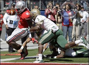 Ohio State's Rod Smith is knocked out of bounds just short of the goal line by Alabama-Birmingham's Lamarcus Farmer, front, Vashon Landers, right.
