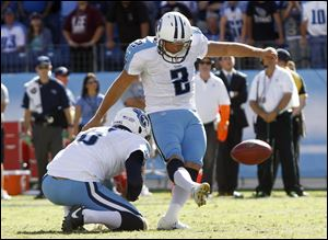 Tennessee Titans kicker Rob Bironas (2) kicks a 26-yard field goal in overtime to defeat the Detroit Lions 44-41 at an NFL football game on Sunday.